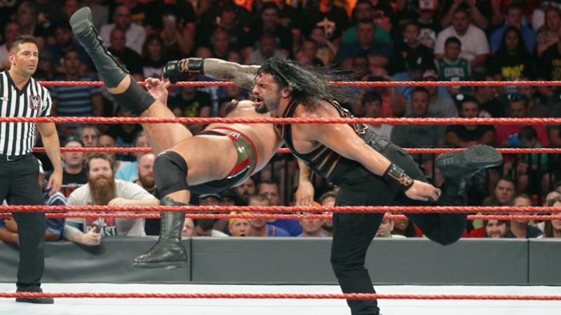 Roman Reigns, demonstrating his devastating Body Odour punch